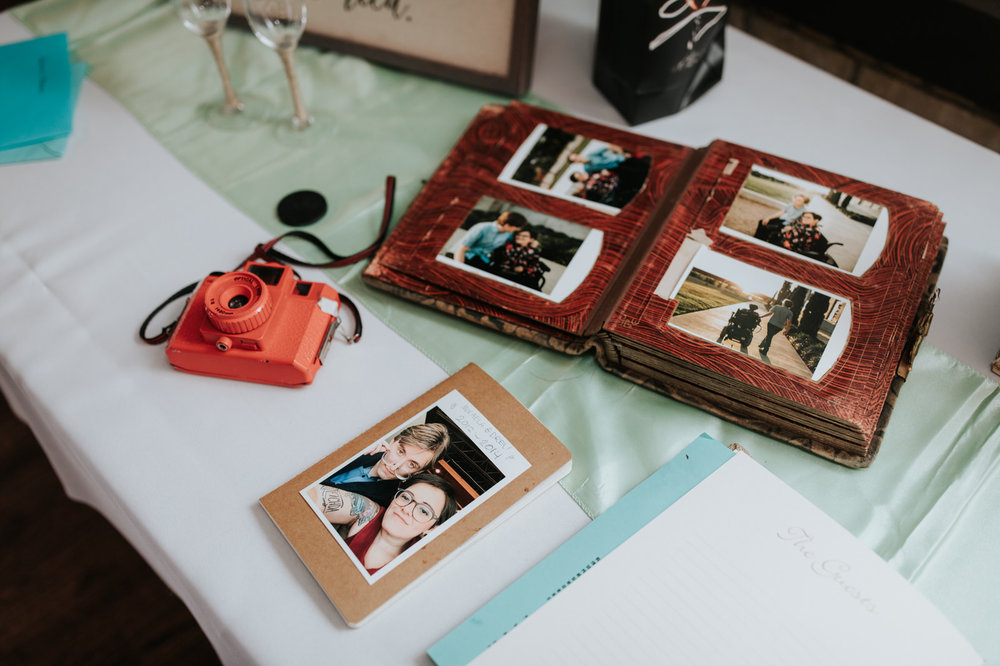 Picture of scrapbook with polaroid and photos