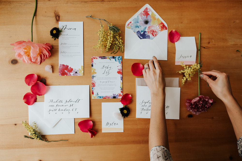 Colorful envelope and flower flat lay
