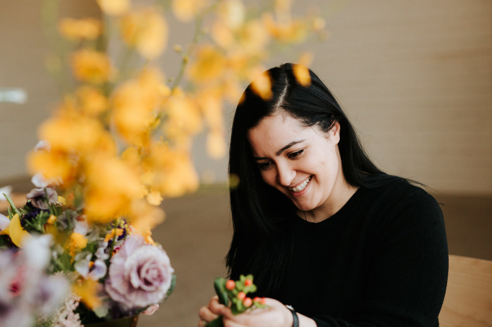 Florist with her flowers at maternity shoot