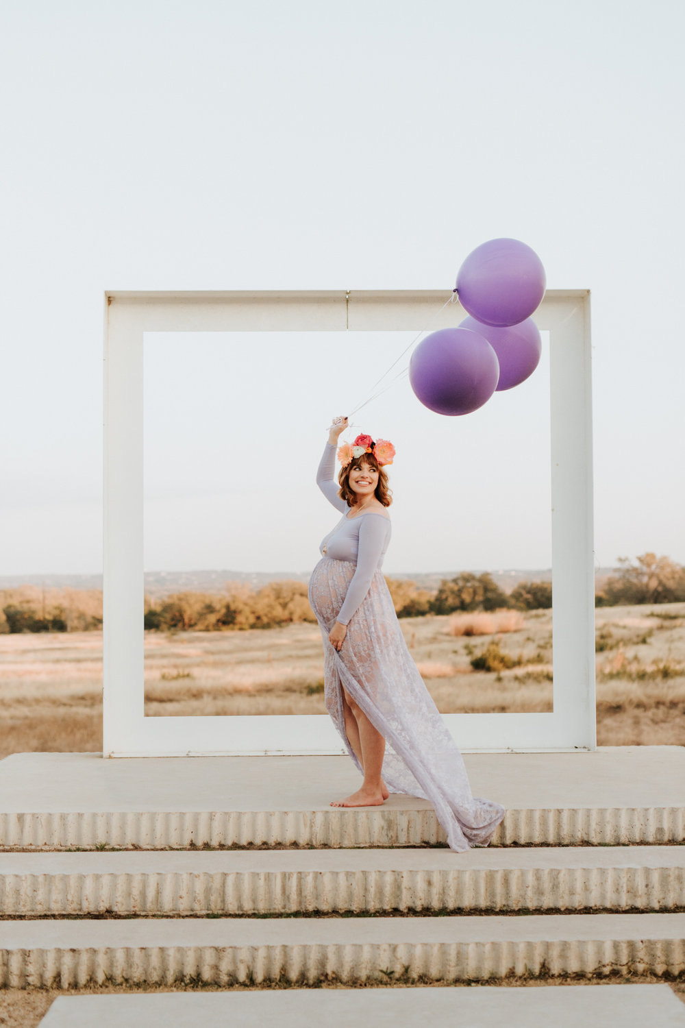 Beautiful pregnant woman at ultraviolet maternity shoot