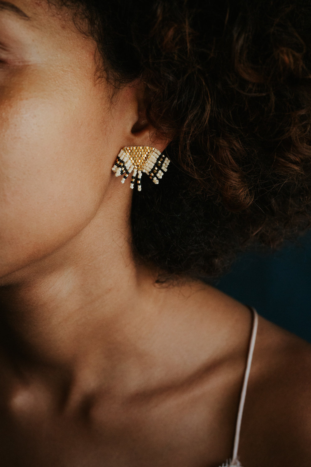 Beautiful woman with Betty Alida earrings on