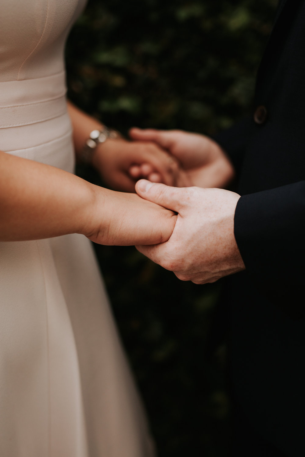 Engaged couple in Houston Texas holding hands