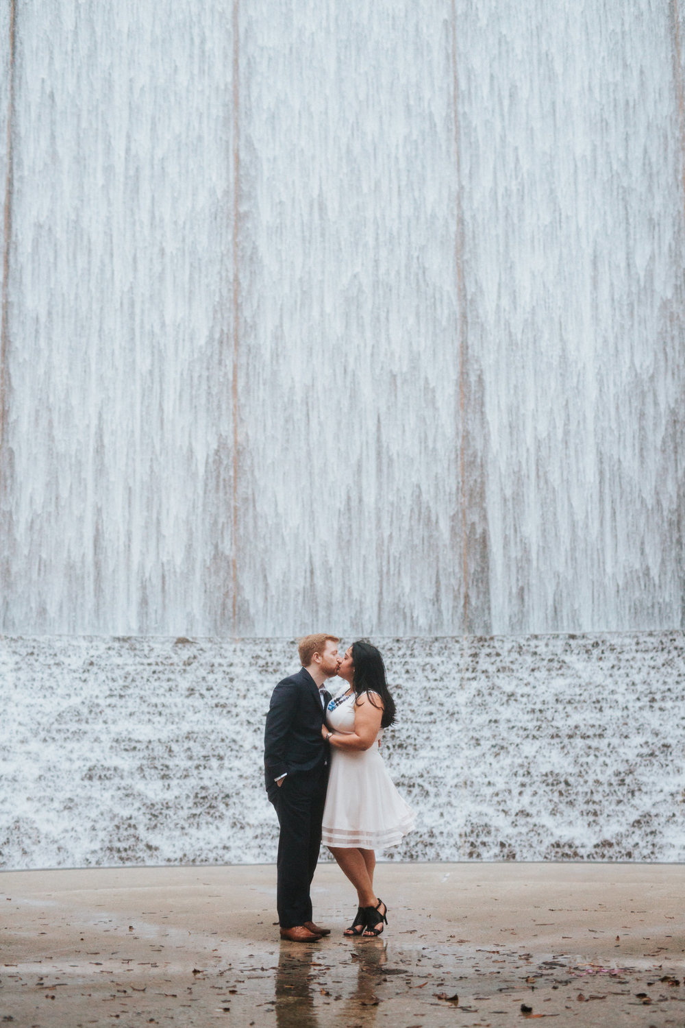 Engaged couple in Houston Texas at the Water Wall