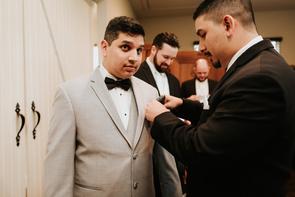 Groom getting ready at wedding