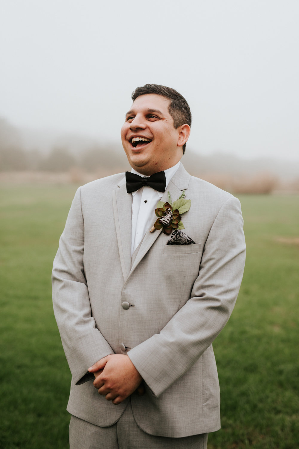 Groom laughing at Pecan Springs Ranch wedding