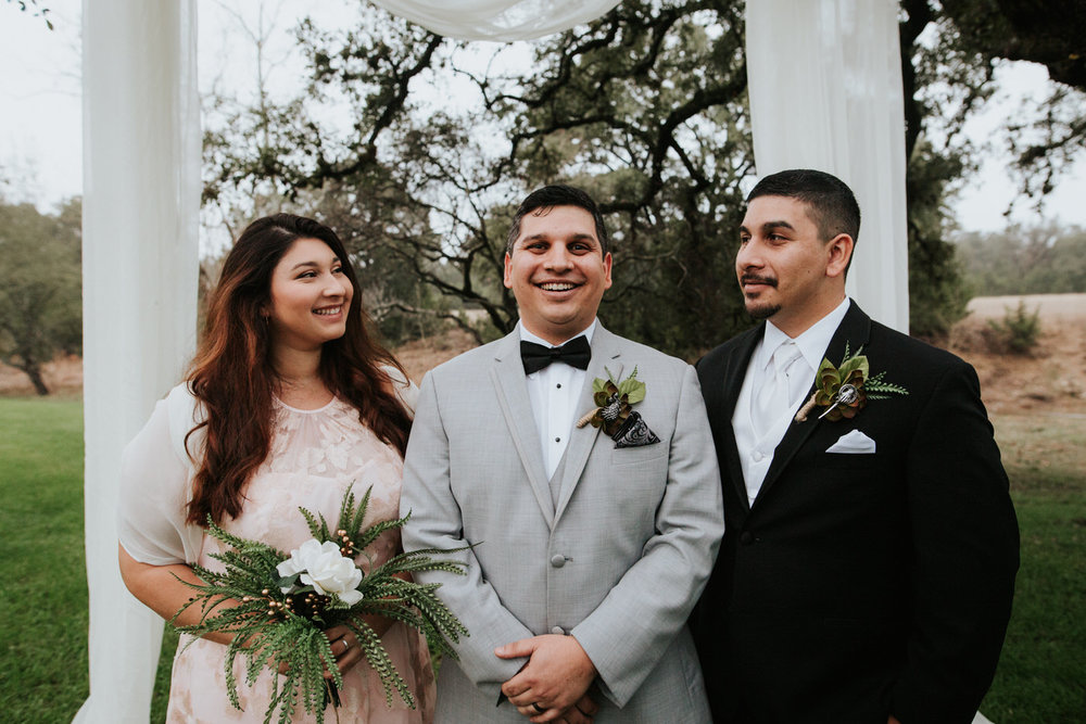 Groom with wedding guests at Austin wedding