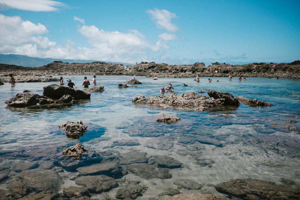 Kids playing in the ocean in Hawaii