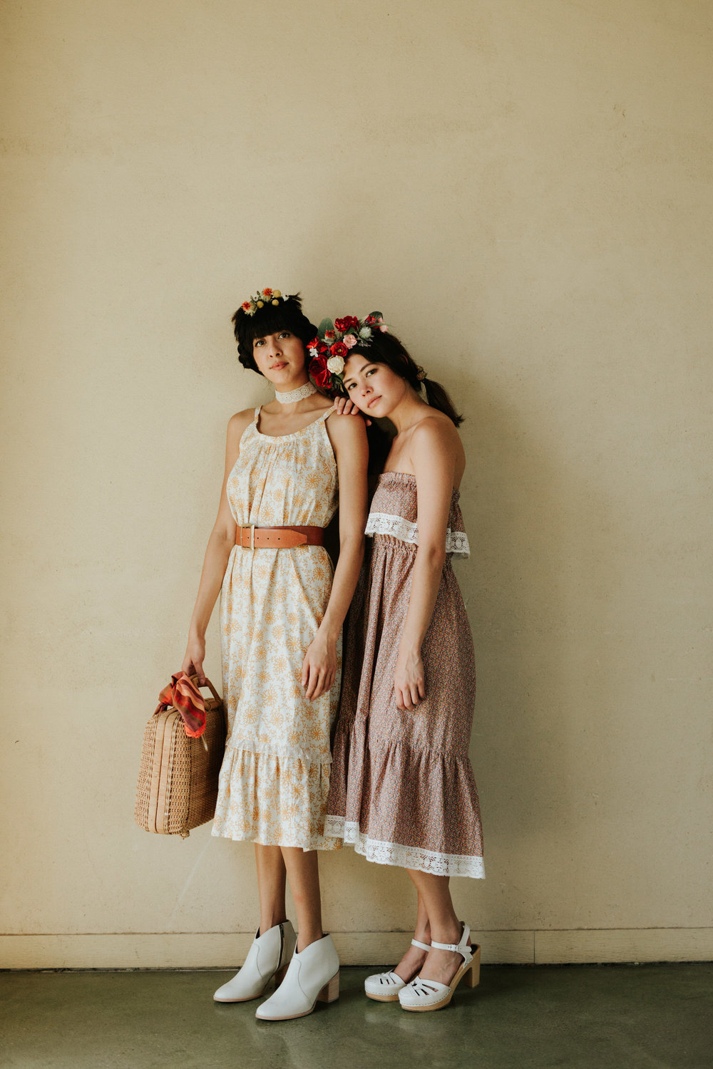 Two women in Rat Des Champs vintage and flower crowns