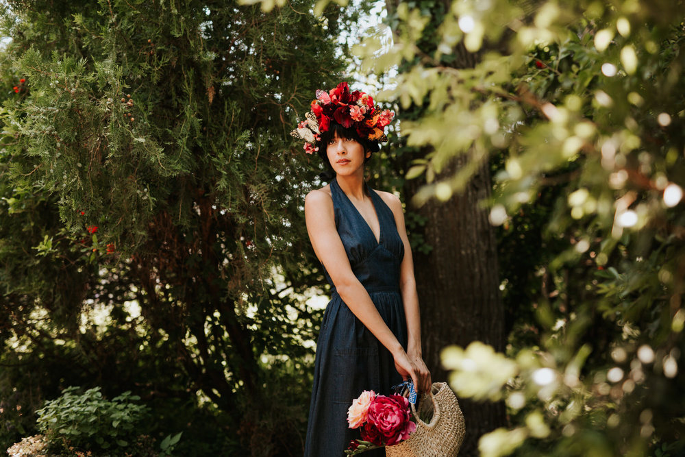 Woman in vintage navy halter dress outside in nature
