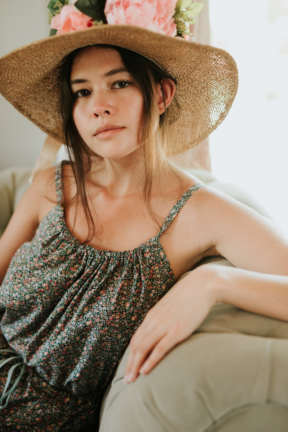 Woman in sun hat and vintage sundress