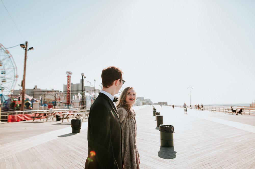Engaged couple at Coney Island boardwalk