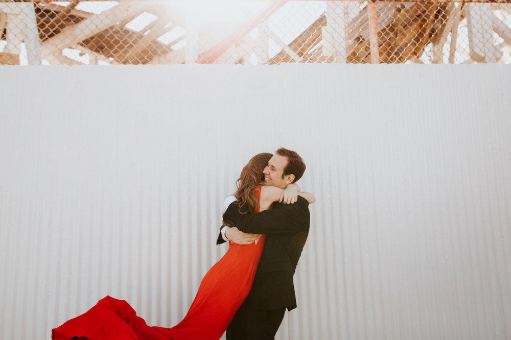 Engaged couple hugging at Coney Island boardwalk