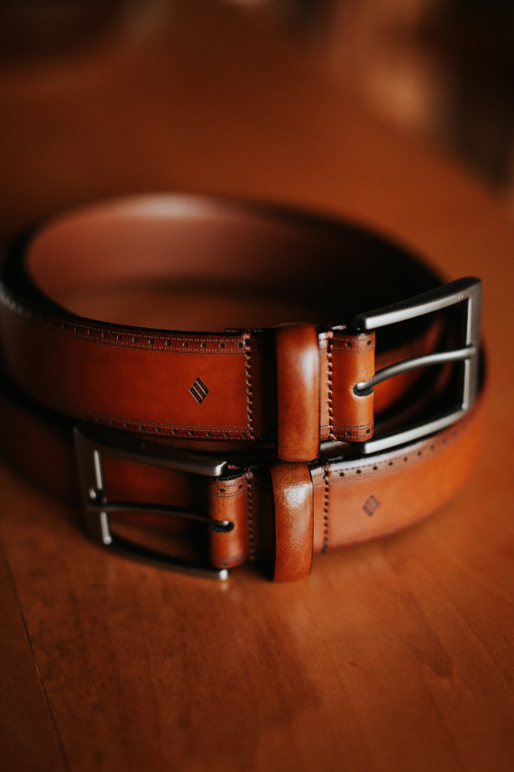 Groom's brown leather belt at Texas hill country wedding