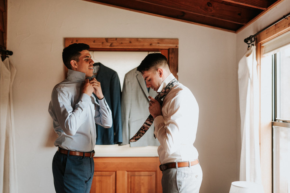 Grooms getting ready for their Texas hill country wedding