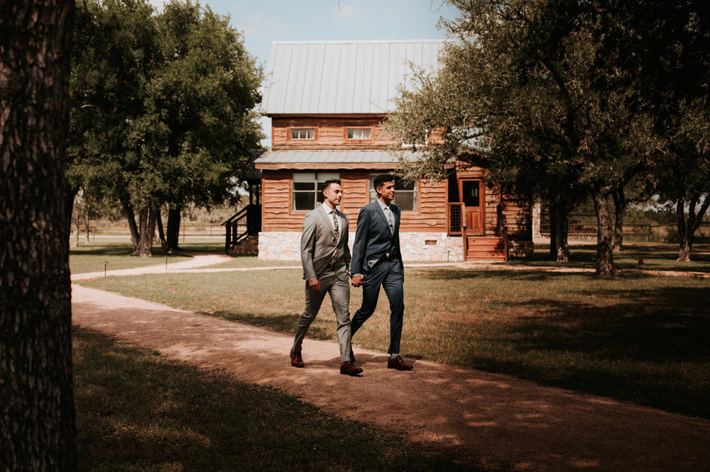 Grooms at their River House at Pedernales wedding