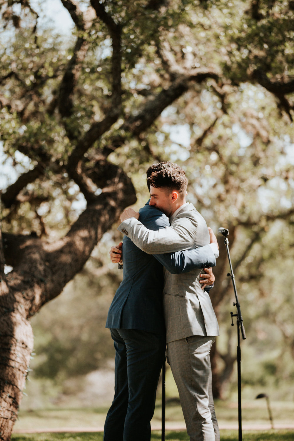 Grooms getting married at River House at Pedernales
