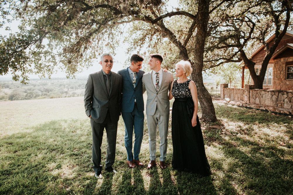 Wedding guests hugging at River House at Pedernales