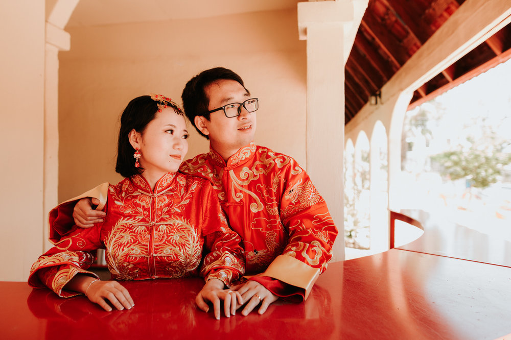 Bride and groom on South Congress in traditional Chinese wedding outfits