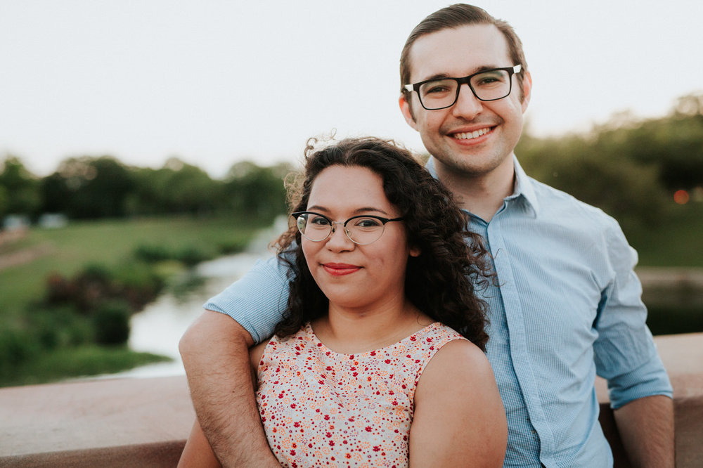Happy engaged couple at Mueller Lake Park