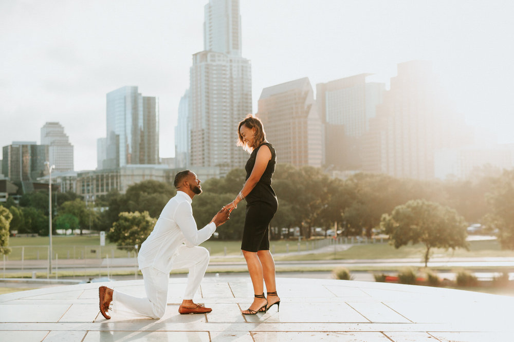 Man proposing to his girlfriend at the Long Center in Austin
