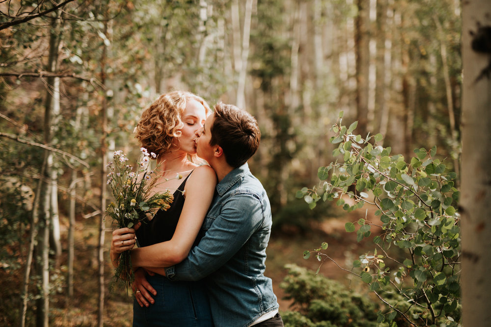 Engaged lesbian couple in Colorado forest