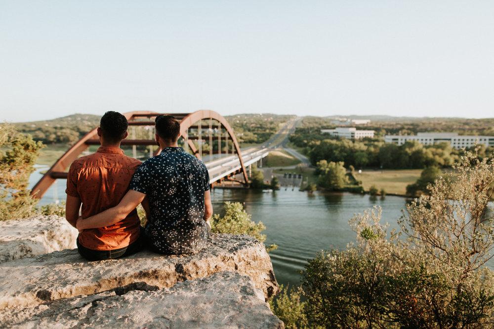 Happy engaged couple overlooking Austin 360 Bridge