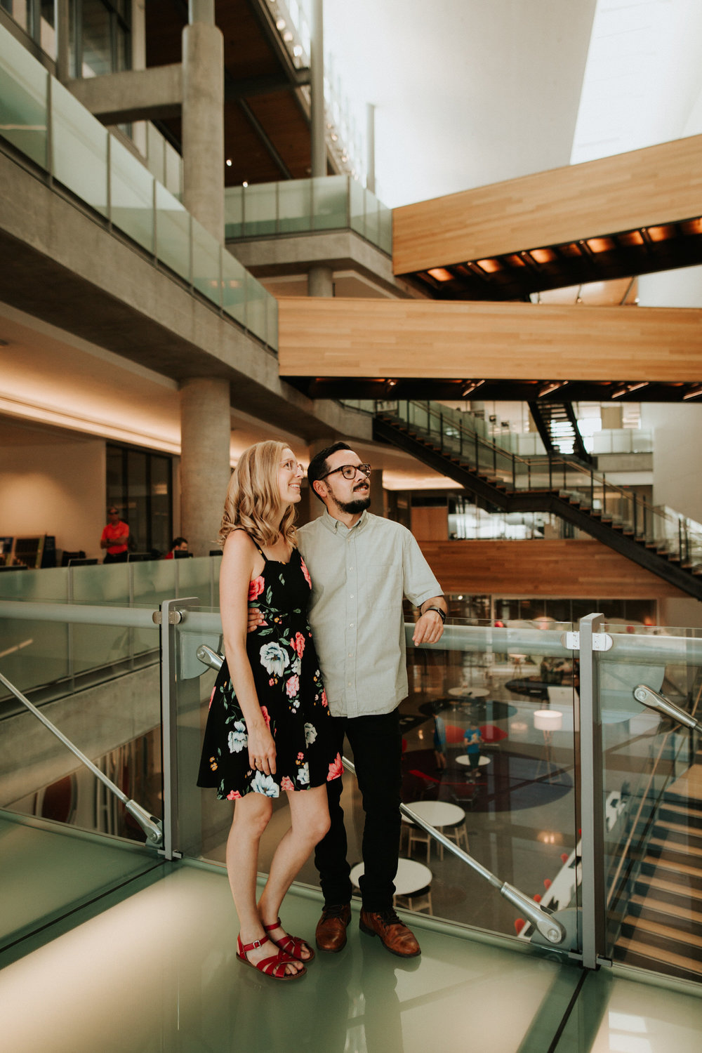 Engaged couple in the Austin central library