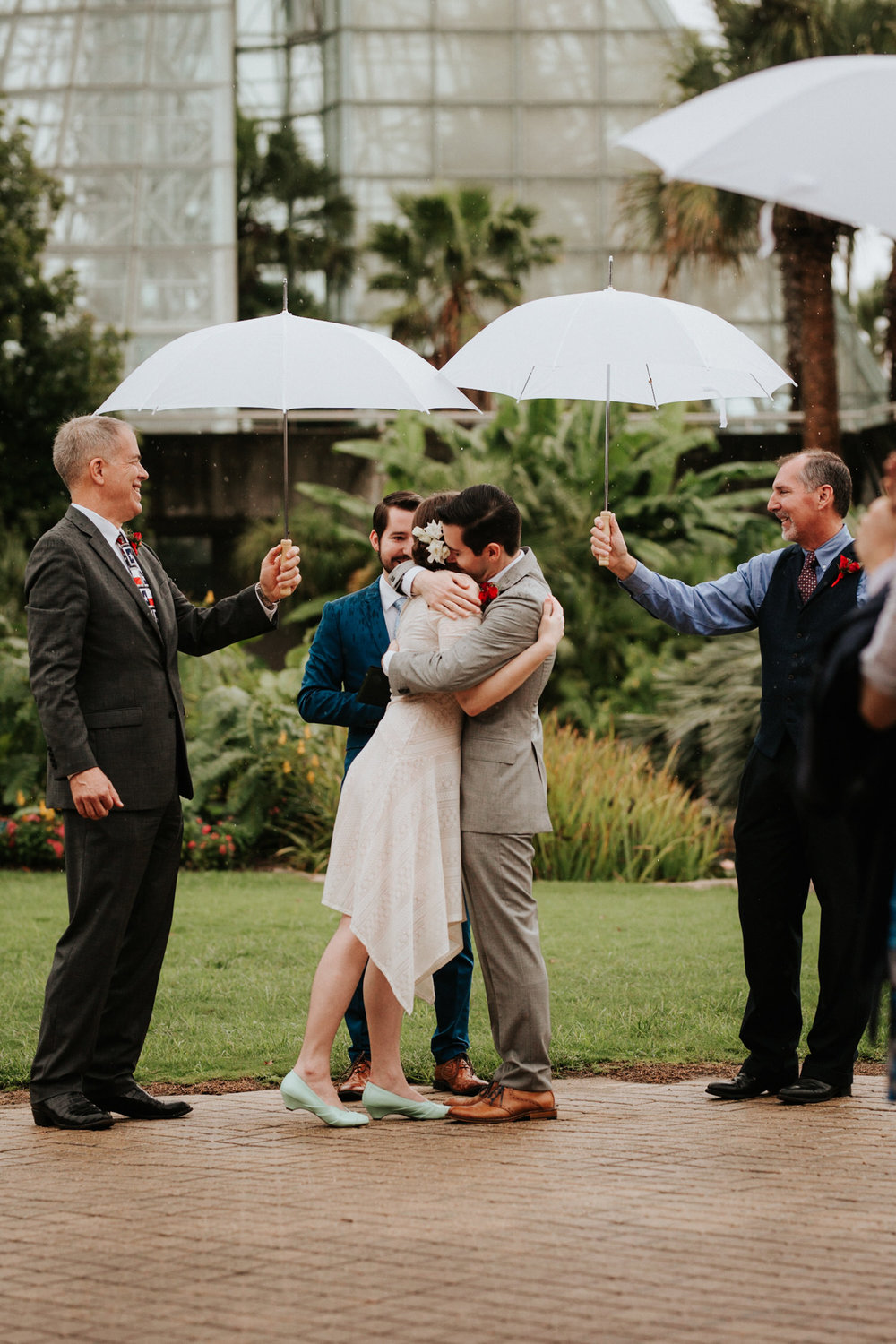 Couple getting married at rainy San Antonio Botanical Garden Wedding