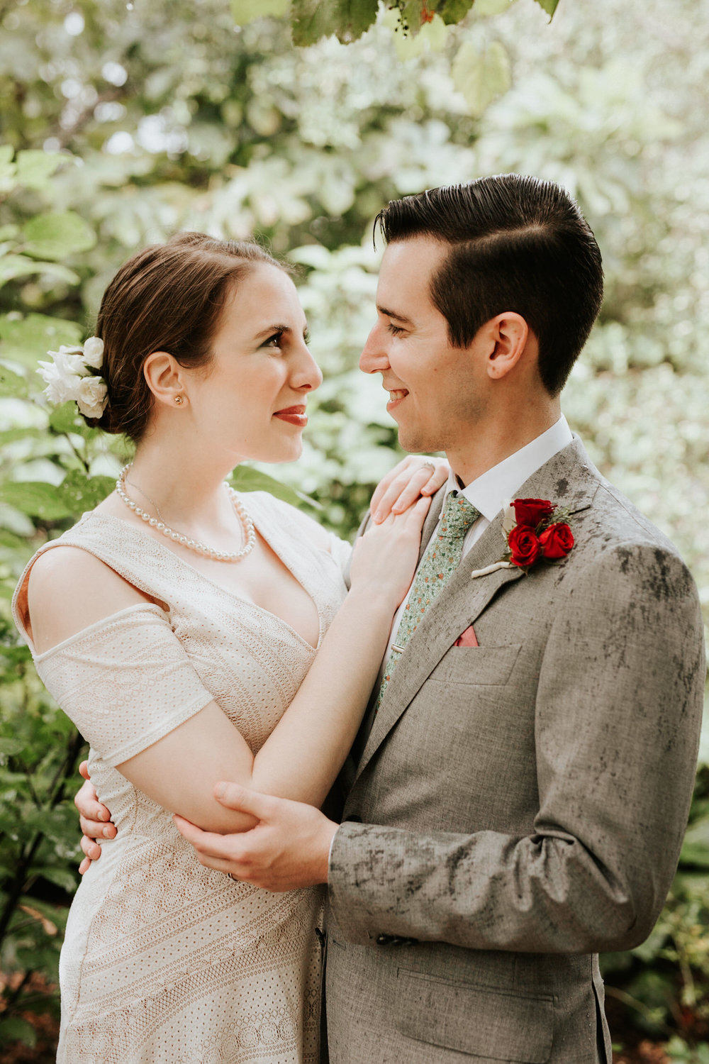 Bride and groom at rainy San Antonio Botanical Garden Wedding