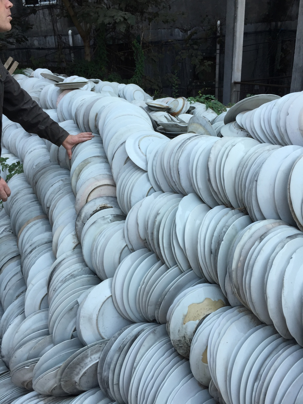 Discarded plates from the old Yuzhou Factory on the grounds at Taoxhichuan