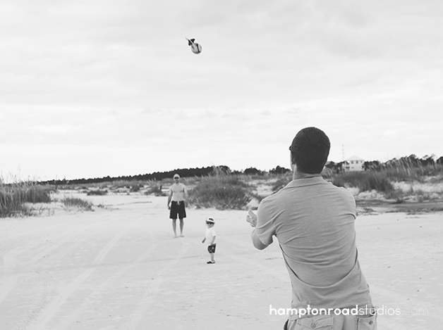 bw matt catching football on beach