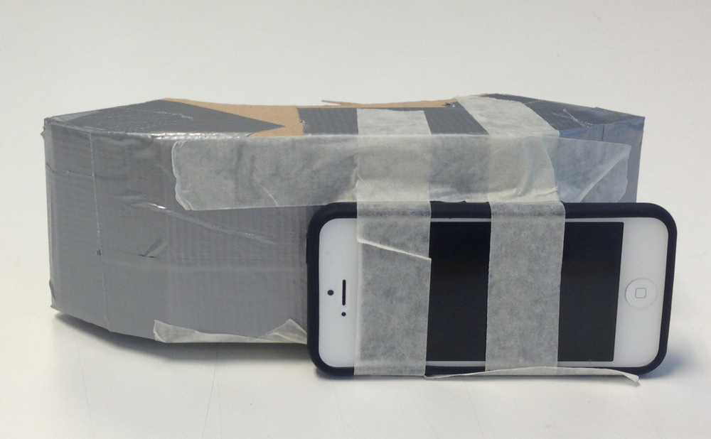 In our third prototype we taped an iPhone to a cardboard mouth-piece