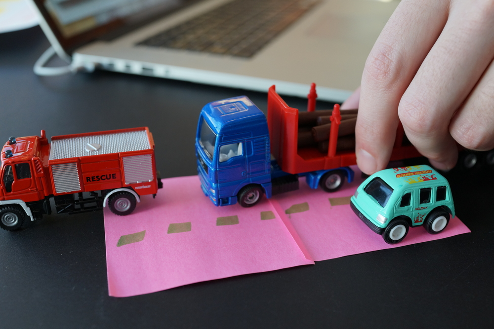 To illustrate what we were all talking about I bought some model cars from the local toyshop. They really proved valuable, as explaining traffic situation is both difficult and annoying.