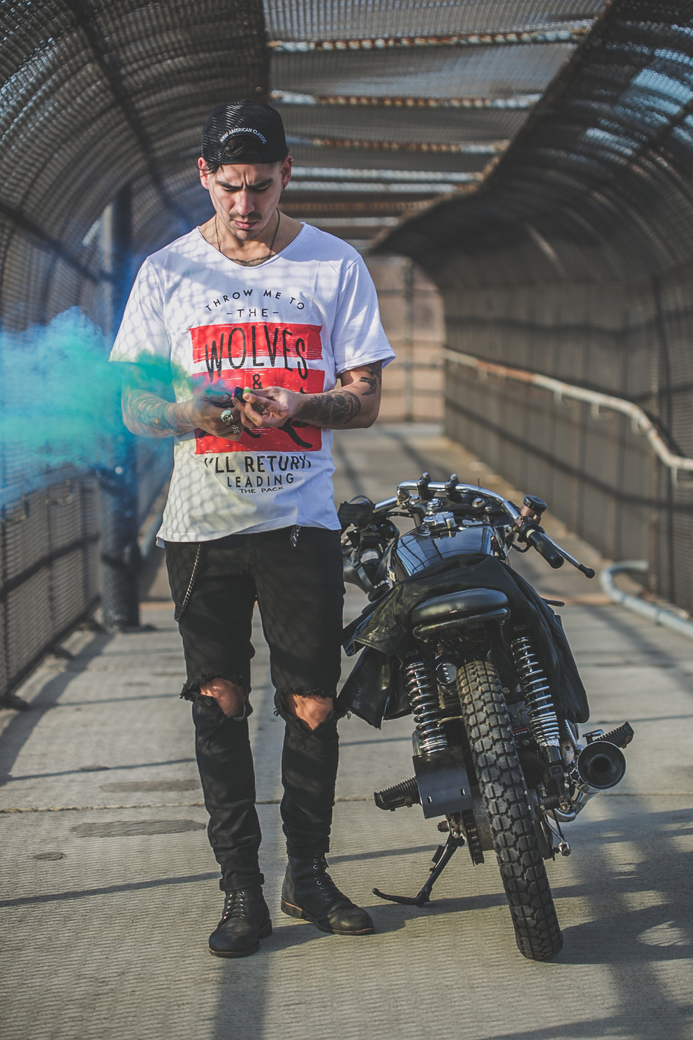 tattooed model in Anchored Apparel with motorcycle