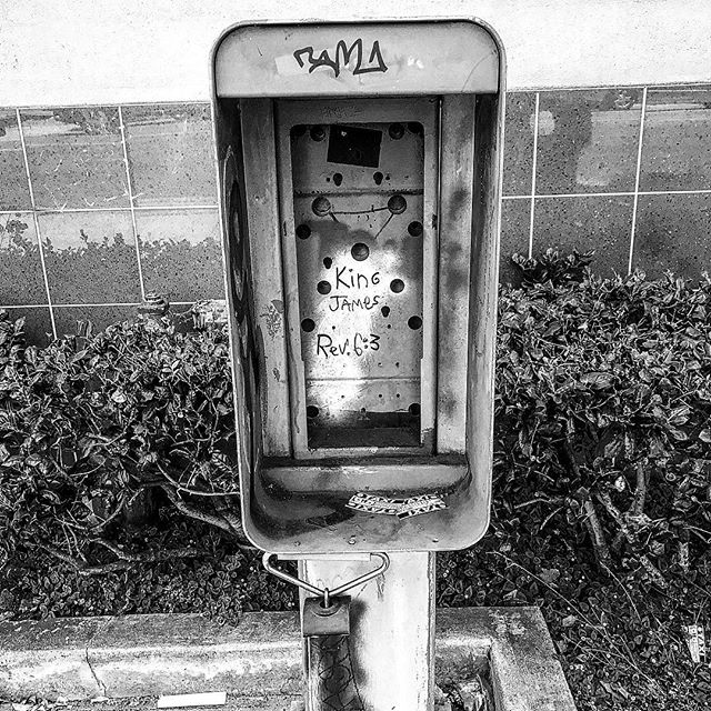 Hey people who believe in a deity: explain the significance of this crazy bullshit in a hollowed-out payphone.