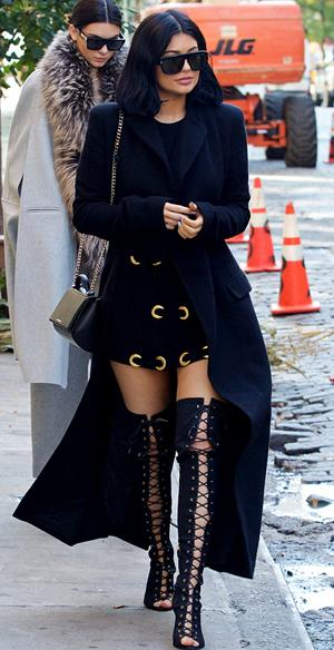 uncomfortable-kylie-jenner-teeters-thigh-high-lace-up-boots.jpg