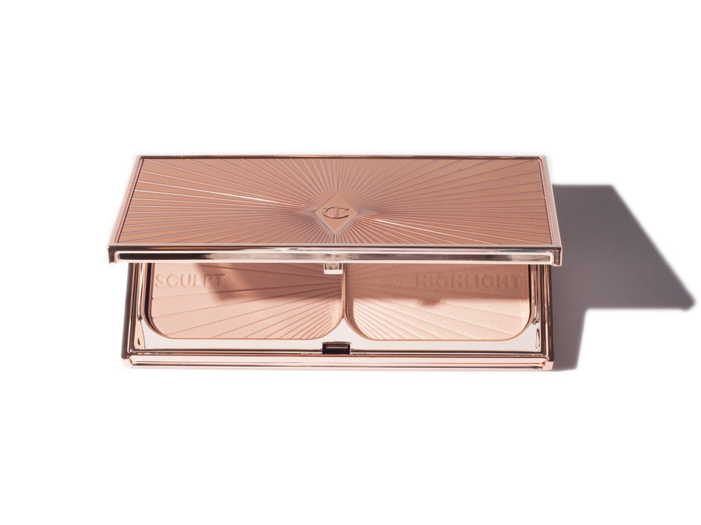 Charlotte Tilbury - The perfect splurge for a contour and highlighter. Besides the beautiful packaging, its face sculpting copacity is ideal to create a regal and chiseled cheek bone.SHOP  →