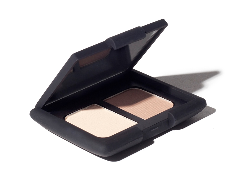 NARS Duo Eye Palette - This NARS Duo Eyeshadow Platte in  colour Madrague is the ultimate eye go-to. The colours appear natural and is the perfect contour palette for eyes. This is the kind of palette that you don't need a mirror but the perfect brush because the pigment glides-on the same every time with a subtle nature.SHOP  →