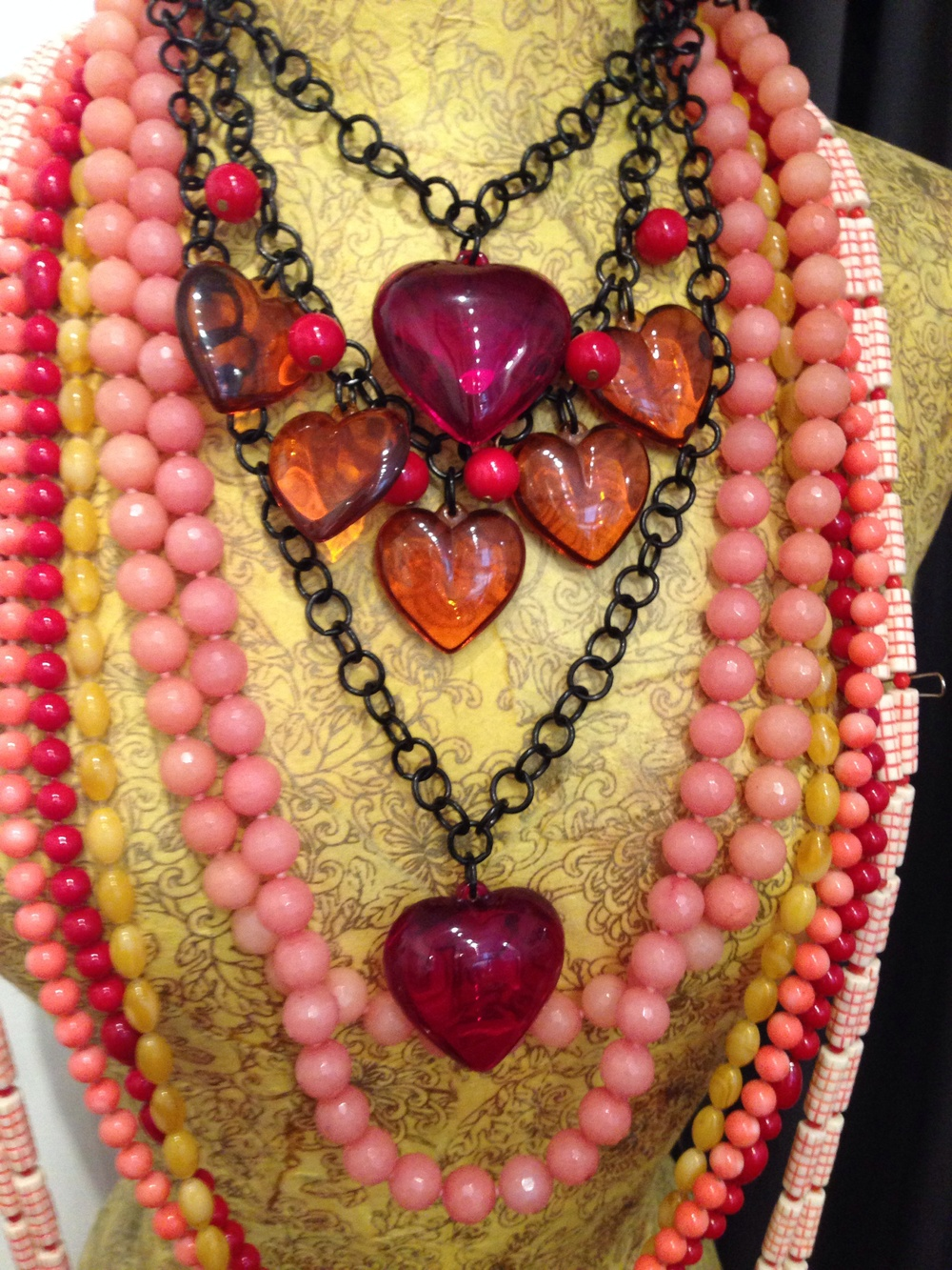 Apple juice hearts with vintage red beads. Single hearts in red plasma. Lots of pink jade, coral and amber strands.