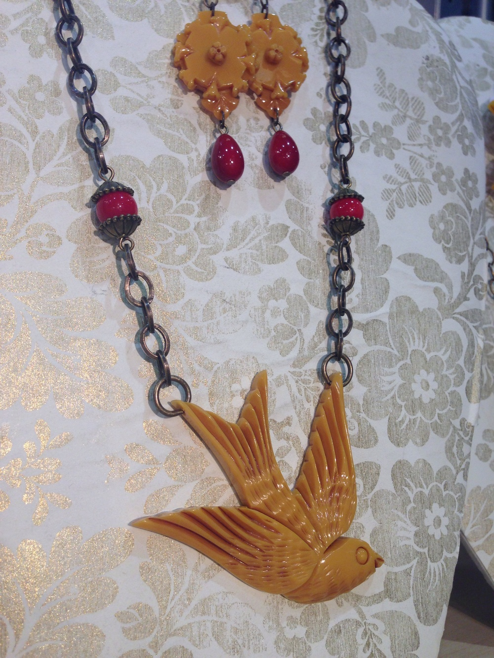 large butterscotch swallow with butterscotch victorian earrings