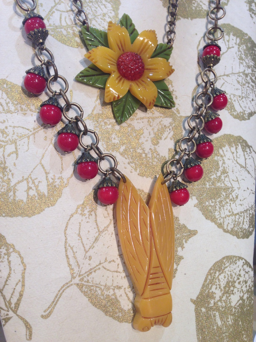 Cicada on chain with vintage beads. And tri-color flower necklace.
