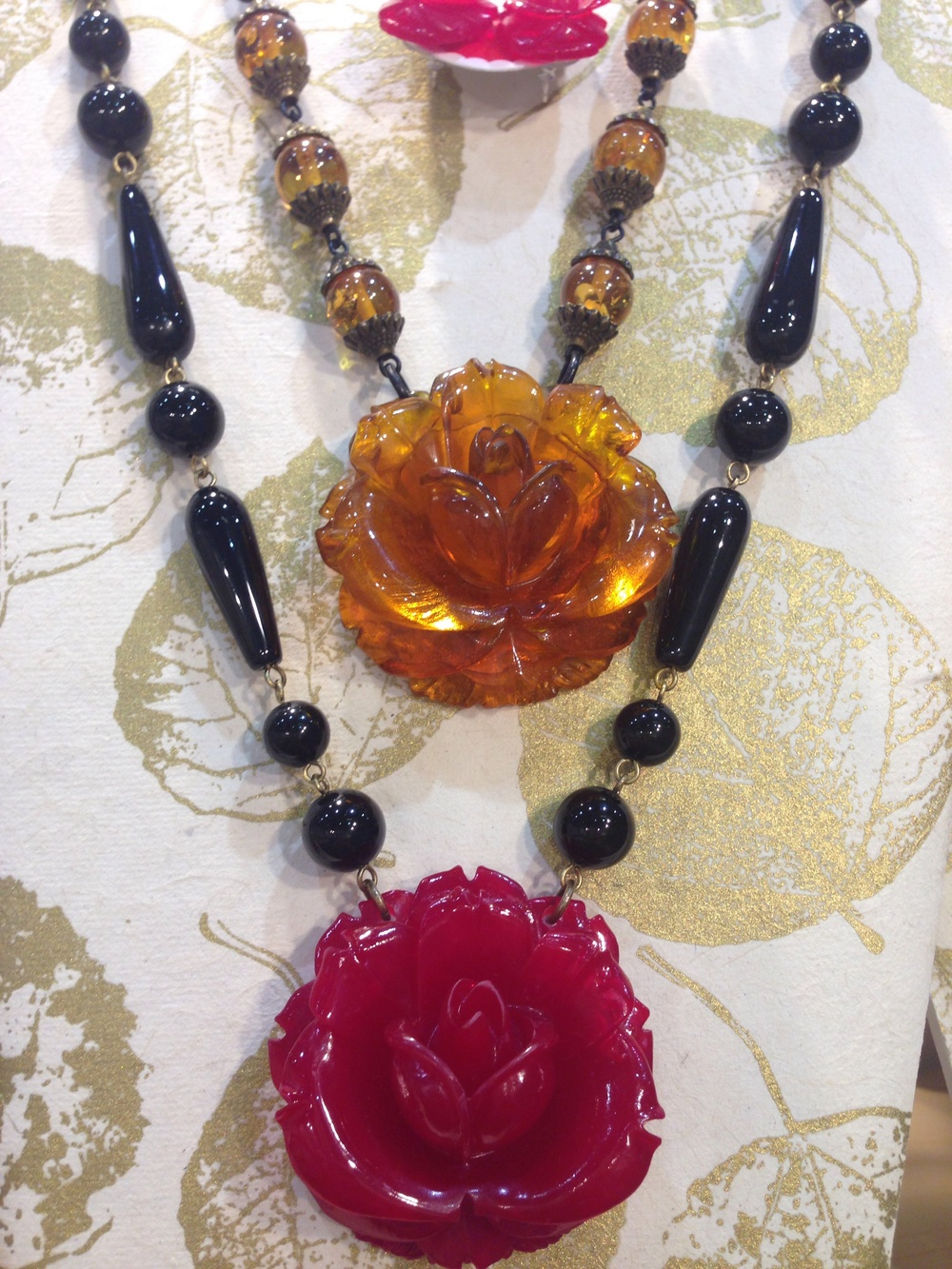 Roses! Big roses!  Paired with black onyx and amber.  Really nice!