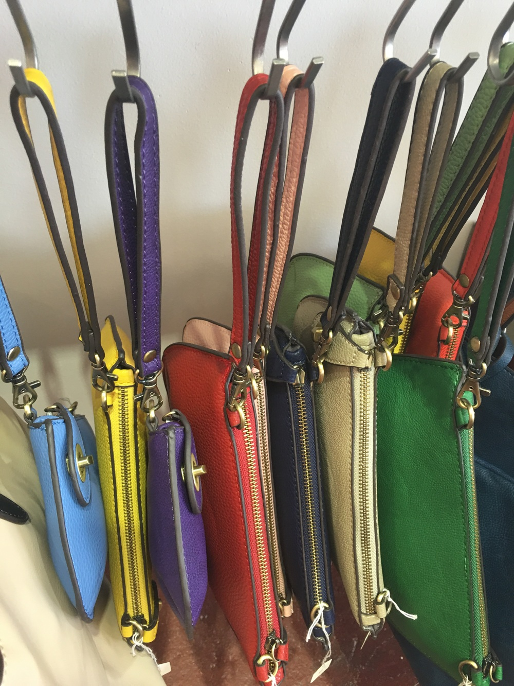 Wristlets that convert to cross body bags, great for summer activity!
