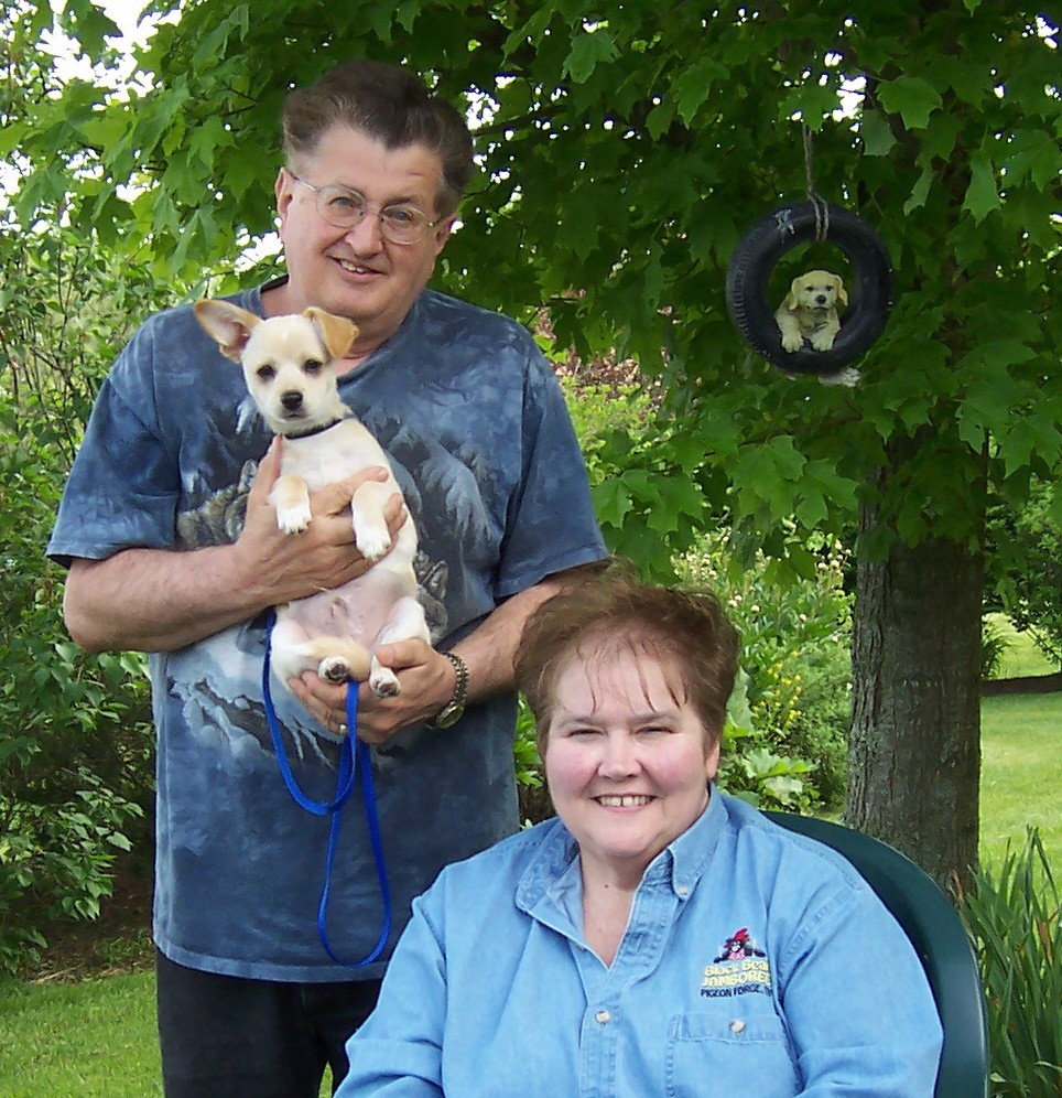 Gary and Charlotte with their dog, Cody, soon after they got him in 2005.