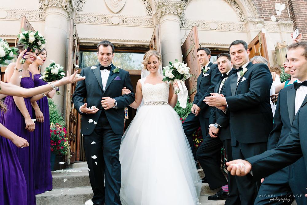 Bride and Groom Exit Through Rose Petals Hoboken Wedding.jpg