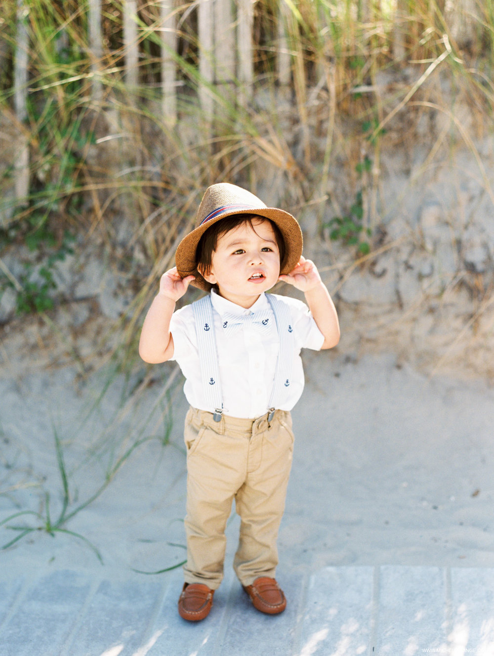 NJ Wedding Photographer at Hotel Icona in Cape May with a cute ring bearer outfit
