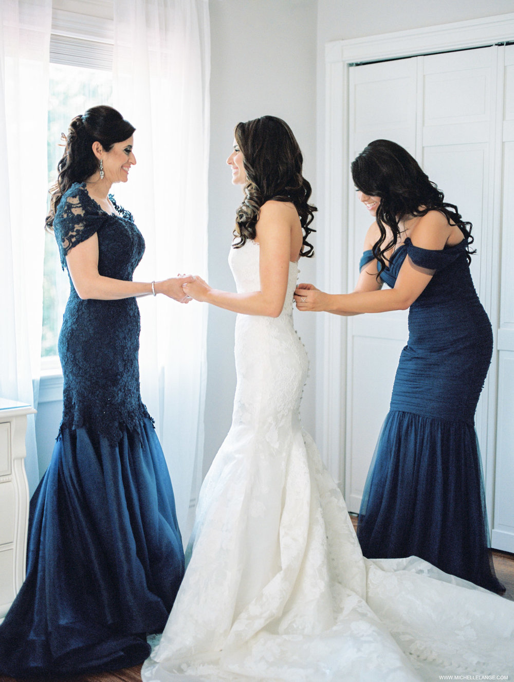 Bride with mom and maid of honor getting ready