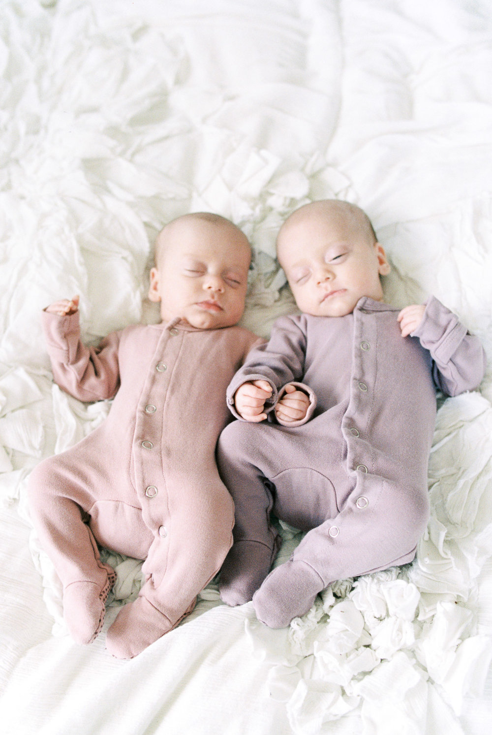 Twin Newborns wearing L'oved Baby Gloved Overalls