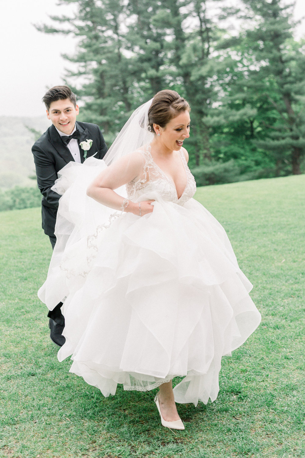 Bride and Groom Running from the Rain