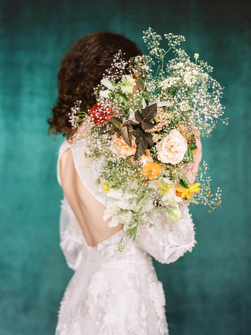 Baby's breath wedding bouquet and Marchesa wedding gown